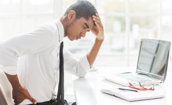 back-pain-desk-poor-posture-black-man-1465293658